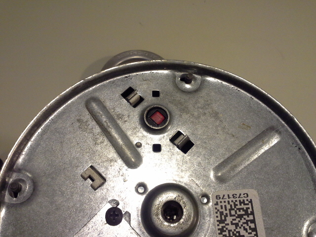 Red reset button on bottom of garbage disposal