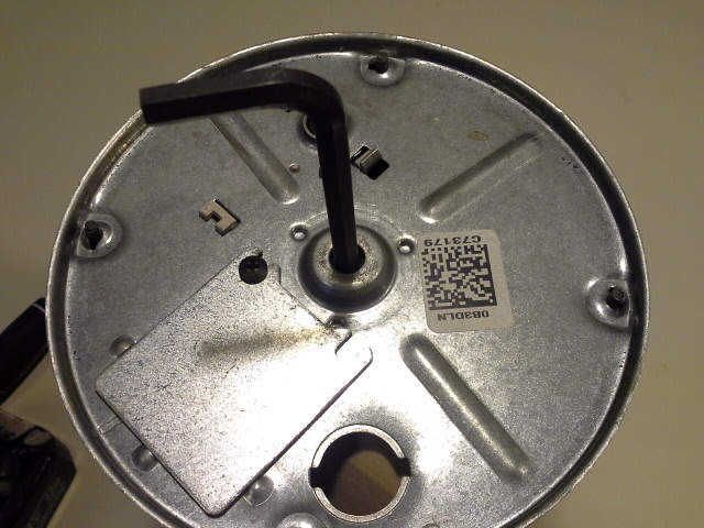 Allen wrench inserted in hex insert at bottom of garbage disposal